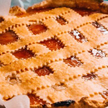 A freshly baked strawberry rhubarb pie with a lattice crust.